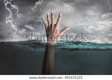 Human hand out from water calling for help - stock photo