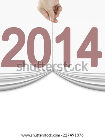 human hand pulling up curtain with dark red 2014 isolated on white background - stock photo