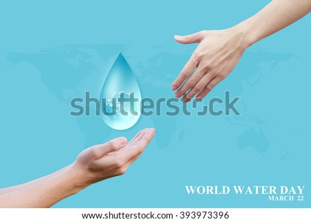 human hand reach water drop with global inside for world water day concept:man gesture palm up to preserve energy of the planet:safe life ideal:Elements of this image furnished by NASA.helping hand. - stock photo