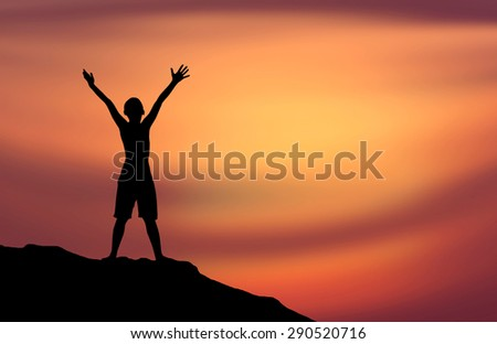 Human hand side silhouette standing on a mountain. Sunset background