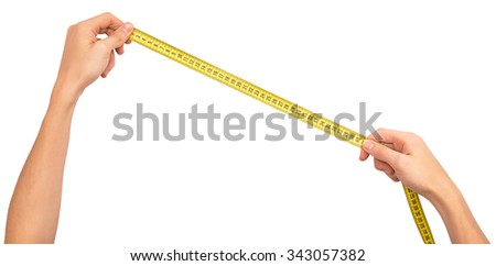 Human hand stretching a measure tape on a white isolated background - stock photo