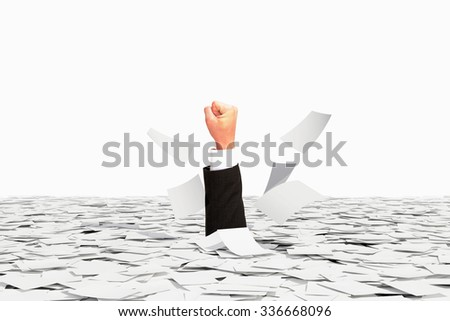 Human hand winner sticks of pile of paper, victory over bureaucracy concept - stock photo
