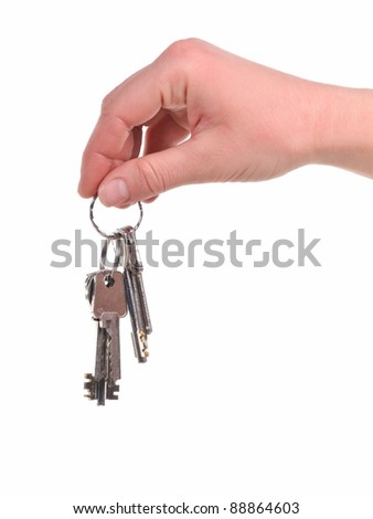 Human hand with a bunch of keys, isolated on white background
