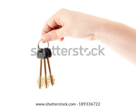 Human hand with bundle of home keys isolated on white background - stock photo
