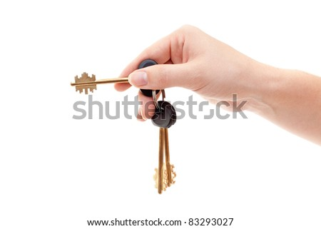 Human hand with bundle of house keys isolated on white background - stock photo