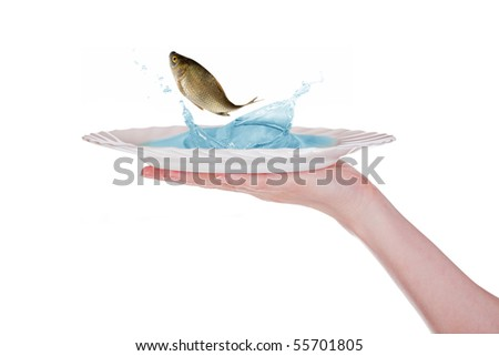 human hand with plate and jumping fish