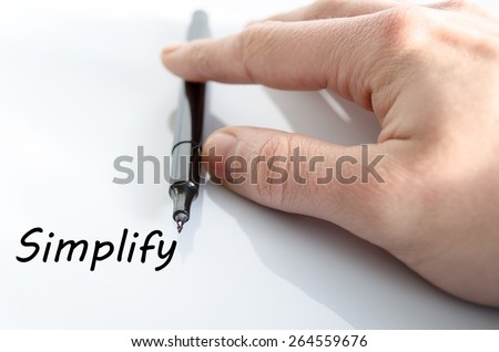 Human hand writing Simplify isolated over white background - business concept - stock photo