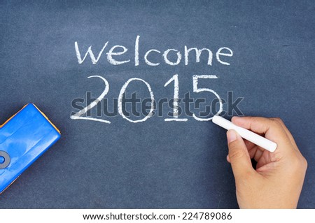 Human hand writing welcome 2015 on chalkboard - stock photo