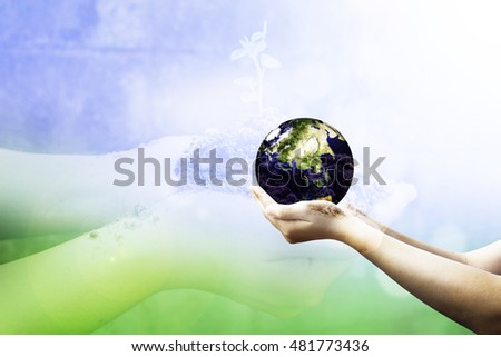 Human hands carrying global Earth. Environment concept. Elements of this image furnished by NASA.hands holding green plant Ecology Earth Hour Spring Time Two Human Planet CSR Arbor Idea Kind Globe