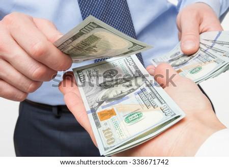Human hands exchanging money - closeup shot - stock photo