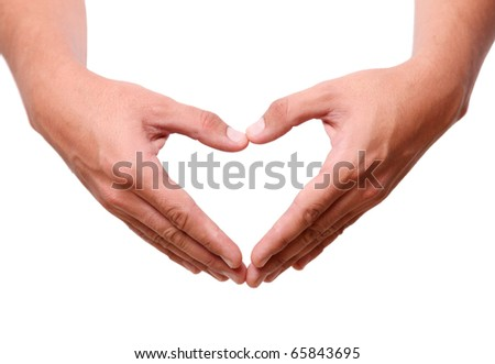 Human hands forming a heart over white background - stock photo