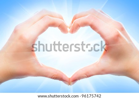 Human hands forming a heart shape - stock photo
