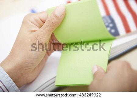 Human hands holding adhesive note with with empty space