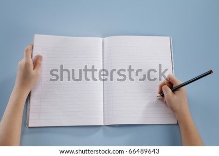 Human hands holding an empty book. - stock photo