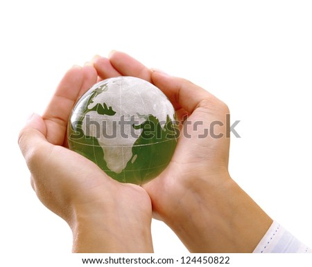 Human hands holding glass earth