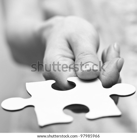 Human hands holding the missing piece . - stock photo