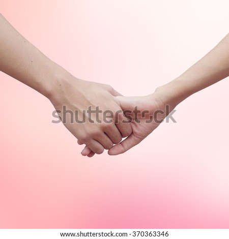 human hands holding together for healing on world cancer day concept:man and woman hand touch for cheerful/hope/love idea:helping and prevent cancer awareness conceptual:medical treatment conception. - stock photo