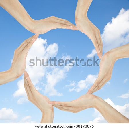 human hands making circle with copy space in the middle - stock photo