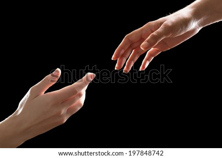Human hands on black background - stock photo