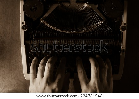 Human hands typing with typewriter,black and white color. - stock photo
