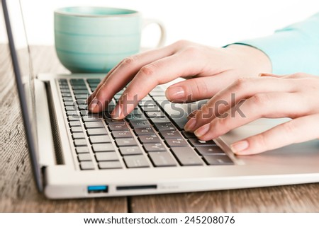 Human hands working on laptop - stock photo