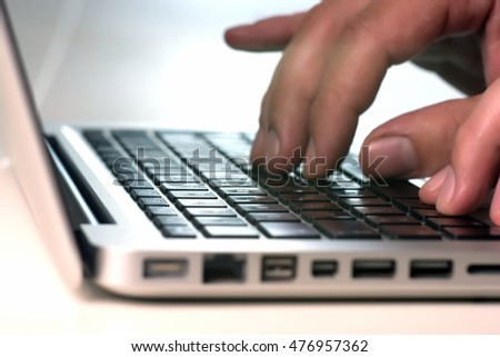 Human hands working on laptop on office background