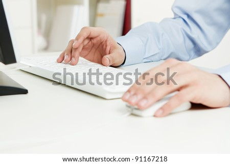 Human hands working on the computer - stock photo