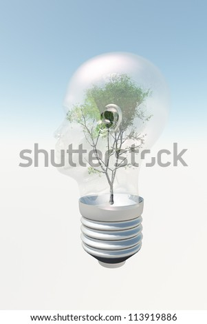 Human head light bulb with tree contained therein - stock photo