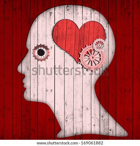 human head with pink gears and heart - stock photo