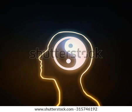 Human head with yin yang icon on dark background  - stock photo
