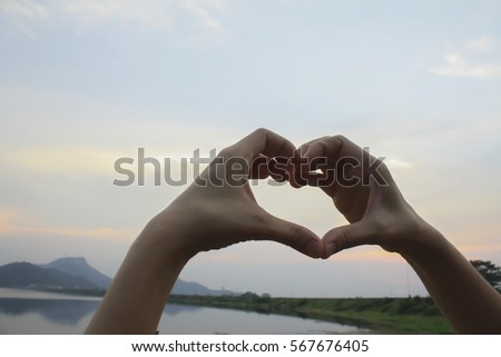 Human heart in the sky background