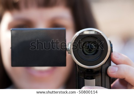 Human home video - adult women holding lens camera - stock photo