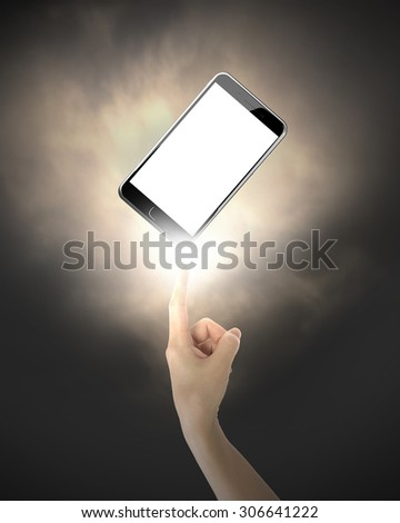 Human index finger pointing at smart phone with white touchscreen, on black background. - stock photo