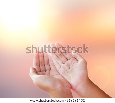 human open empty hands over blurred background
