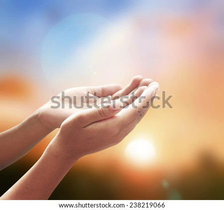 Human open empty hands with palms up over blurred sunset background. Thanksgiving, Christmas background, Worship, Forgiveness, Mercy, Humble, Repentance, Reconcile, Adoration, Glorify concept. - stock photo