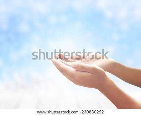 Human open empty hands with palms up, over blurred winter background. Blurred winter for Merry Christmas and Happy New Year 2016 Worship, Forgiveness, Mercy, Humble, Repentance, Redeemer concept.