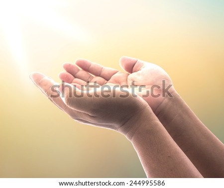 Human open two empty hand with palms up. Ask Trust Beg Help God Soul Pray Dua Hajj Give Bless Quran Aura Healer Life Gift Eid Islam Glow Prayer Macca Soul Creation Dream Source Nature Devine concept - stock photo