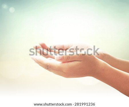 Human open two empty hands with palms up. Ask Pose Seek Beg Help Race God Soul Pray Dua Hajj Give Bless Quran Aura Heal Life Gift Eid Poor Idea Islam Thank Room Glow Prayer Macca Soul Bokeh concept - stock photo