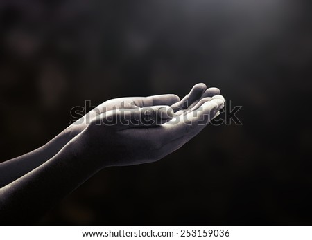 Human open two empty hands with palms up. Ask Pose Seek Beg Help Race God Well Soul Pray Dua Hajj Give Bless Quran Aura Heal Life Gift Eid Poor Idea Islam Thank Room Candle Glow National Africa Prayer - stock photo