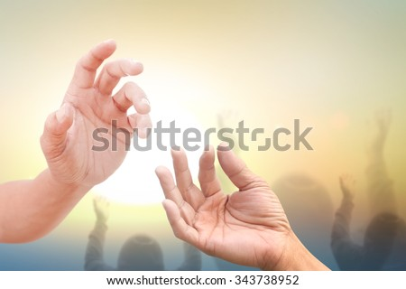 human pray over sky with light of hope near the mountain in desert - stock photo