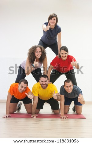 Human Pyramid and Thumbs Up - stock photo