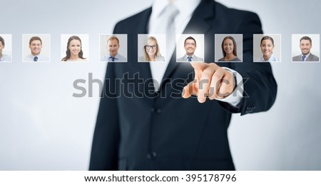 human resources, career management, recruitment and success concept - man in suit pointing to of many business people portraits - stock photo