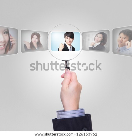 Human Resources concept - Job search and career choice employment with magnifying glass, asian model - stock photo