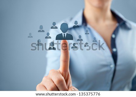 Human resources, CRM and social networking concept - female officer choose person (employee, successor) represented by icon. - stock photo