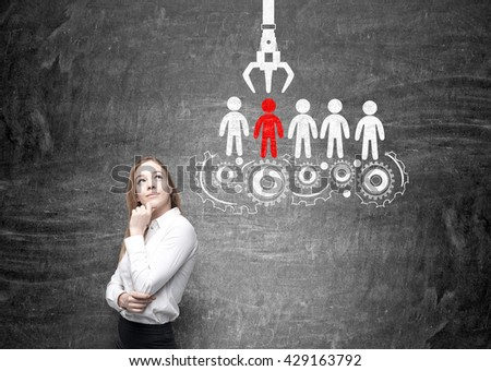Human resources management and choice concept with thoughtful businesswoman and sketch on chalkboard background - stock photo