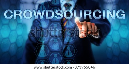 Human Resources manager is touching CROWDSOURCING onscreen. Countless male and female knowledge worker icons embedded in a hexagonal planning matrix do stream across the screen. Business concept. - stock photo