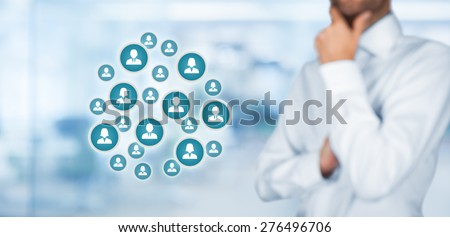 Human resources officer think about employees, or marketing specialist think about customers. Wide composition, office in background.  - stock photo