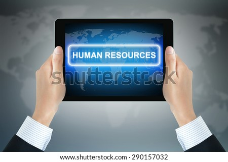 HUMAN RESOURCES sign on tablet pc screen held by businessman hands - stock photo