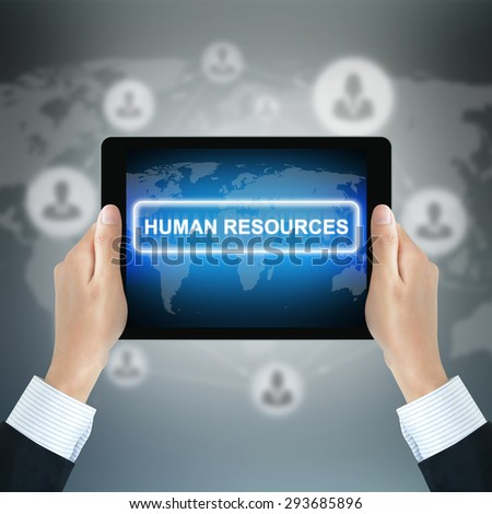 HUMAN RESOURCES sign on tablet pc screen held by businessman hands