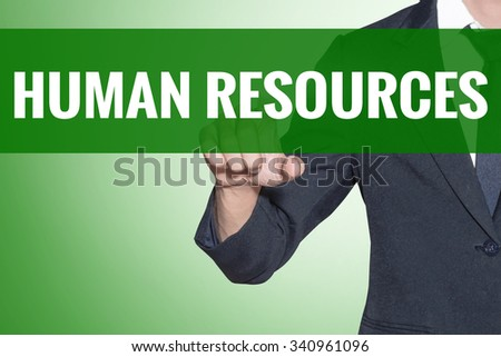 Human Resources word Business man point on green tab virtual screen - stock photo